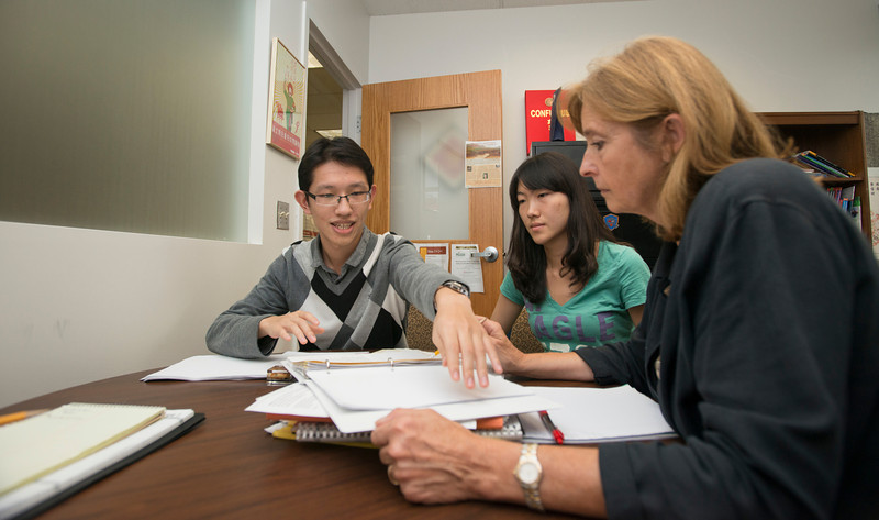 Undergraduate and China 1+2+1 students Xiaoxiao Zhang (C) and Xiaohan Li (L) work with Madelyn Ross, Director of China Initiatives, at Fairfax campus. Photo by Alexis Glenn/Creative Services/George Mason University
