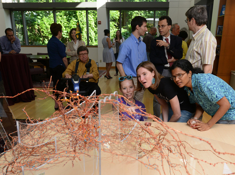 Students recognize how the Mental Floss sculpture represents the mamillian brain, at Mason's Krasnow Institute for Advanced Study opening reception. Photo by Evan Cantwell/Creative Services/George Mason University