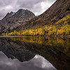 Reflections of autumn on a lake in the Sierra mountains