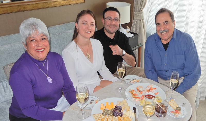 Mimi, Carol, Christian and Richard enjoy some bubbly and appetizers in our stateroom