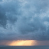 Sunset breaking through rain storm clouds in Northern California