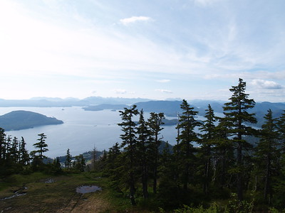 The view from Harbor Mountain. The snow didn't melt enough until the end of June to get up to the top. And I went the first day it was open; my last day in Sitka in 2007. We were blessed with beautiful weather. From what I've read, there were gun placements up here during World War II (2007).