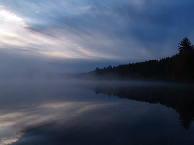 Morning fog and sunrise on Swan Lake