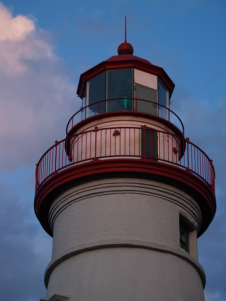 A little orange from the sunset reflecting off the top of the lighthouse.