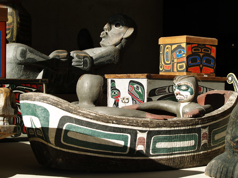 This is an interior shot from the Museum of Anthropology at the University of British Columbia. They have a fabulous global collection available for viewing but the most striking collection are 19th and 20th century First Nations totems, boxes and figures. With the strong early evening sun streaming through glass windows, the bold colors show up very well on these artifacts (2006).