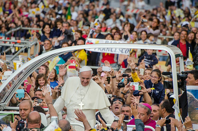 "Cagliari, Italy. 22.09.2013. Pope Francis greets the crowd from the ""Papamobile"" at he arrives to the meeting with workers, which is his first stop in Sardinia. (IT) Papa Francesco saluta i fedeli al suo arrivo in Sardegna prima dell'incontro con i lavoratori."