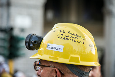 Cagliari, Italy. 22.09.2013. A worker of the mining company called Carbosulcis wears an helmet dedicated to Pope Francis.