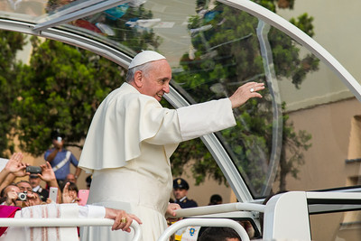 "Cagliari, Italy. 22.09.2013. Pope Francis greets the crowd from the ""Papamobile"" at Sanctuary of Our lady of Bonaria. (IT)  Papa Francesco saluta la folla di pellegrini al suo arrivo al Santuario di Bonaria."