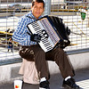 Man playing the accordion for money.