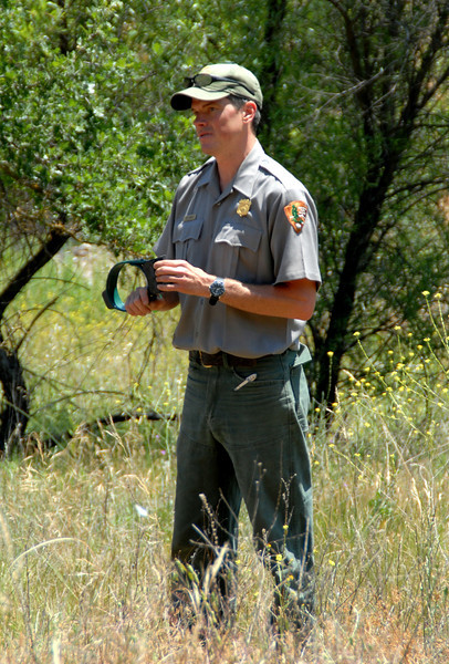 A Park Ranger explains the tracking collar used for local bobcats.<br /> National Geographic Bio-Blitz.<br /> Santa Monica Mountains, CA.  May 2008