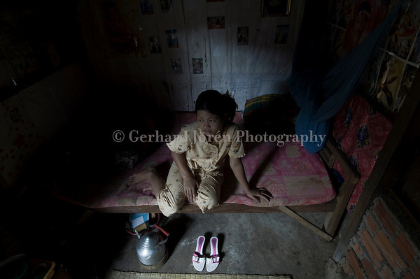 Cheing Pisey, 18, works in a one woman brothel in Phnom Penh. She has worked for 2 years and earns about 15 USD a months