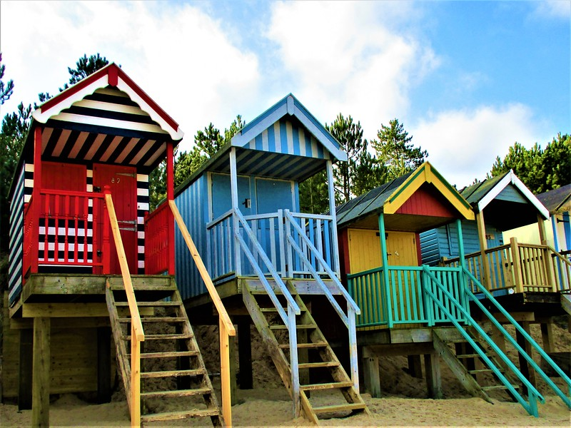 Colorful beach huts on stilts
