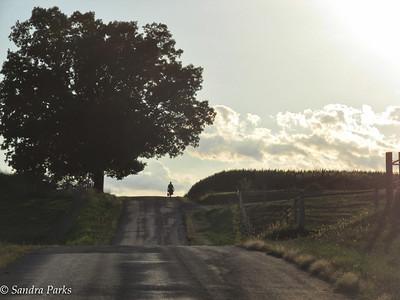 8-3-15:  Mennonite woman, walking home down Majestic View.
