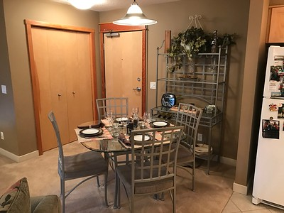 "Our ""dining area"" table.  The entrance door is in the center and a coat/shoe closet is on the left.  There are also extra backpacks and hiking poles in there."