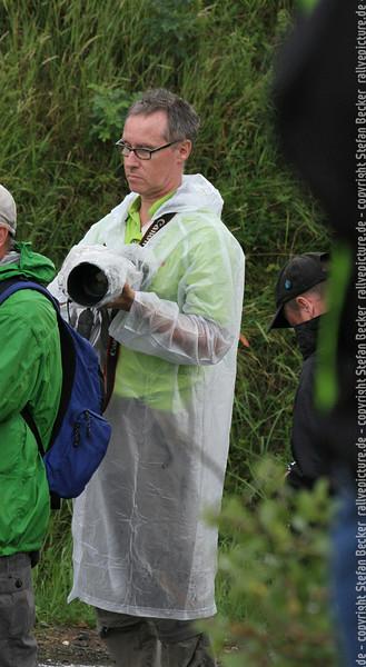 in Plastik Outfit, weil die Rallye mal wieder den üblichen Regentag hatte - Eifel Rallye Festival 2014