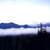 1996-08-15 - Fog with mountains poking through near Tofino, BC, Canada