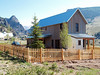 """Oblique view of small """"board and batten"""" house in Creede America neighborhood, Creede, CO"""