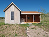 House with front porch in Creed America neighborhood in Creede, CO