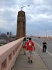 2012-04-20 - Intrepid tour leader Ken Kalynchuk directs URS students across a bridge in Cleveland