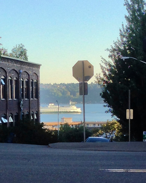 2013-07-24 - A ferry passes by while sitting at Black Bottle in Belltown