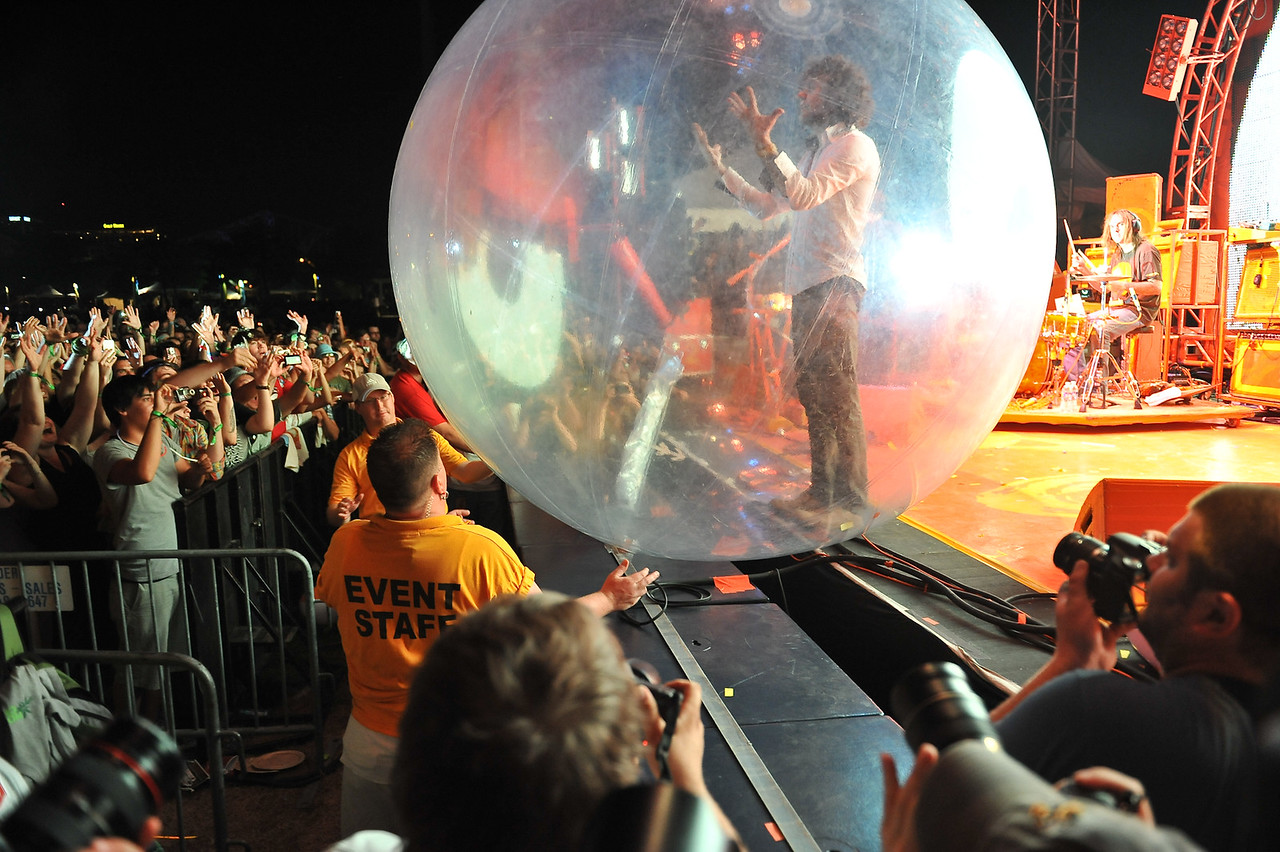 Flaming Lips frontman, Wayne Coyne, gets ready to roll around the crowd inside this huge ball.