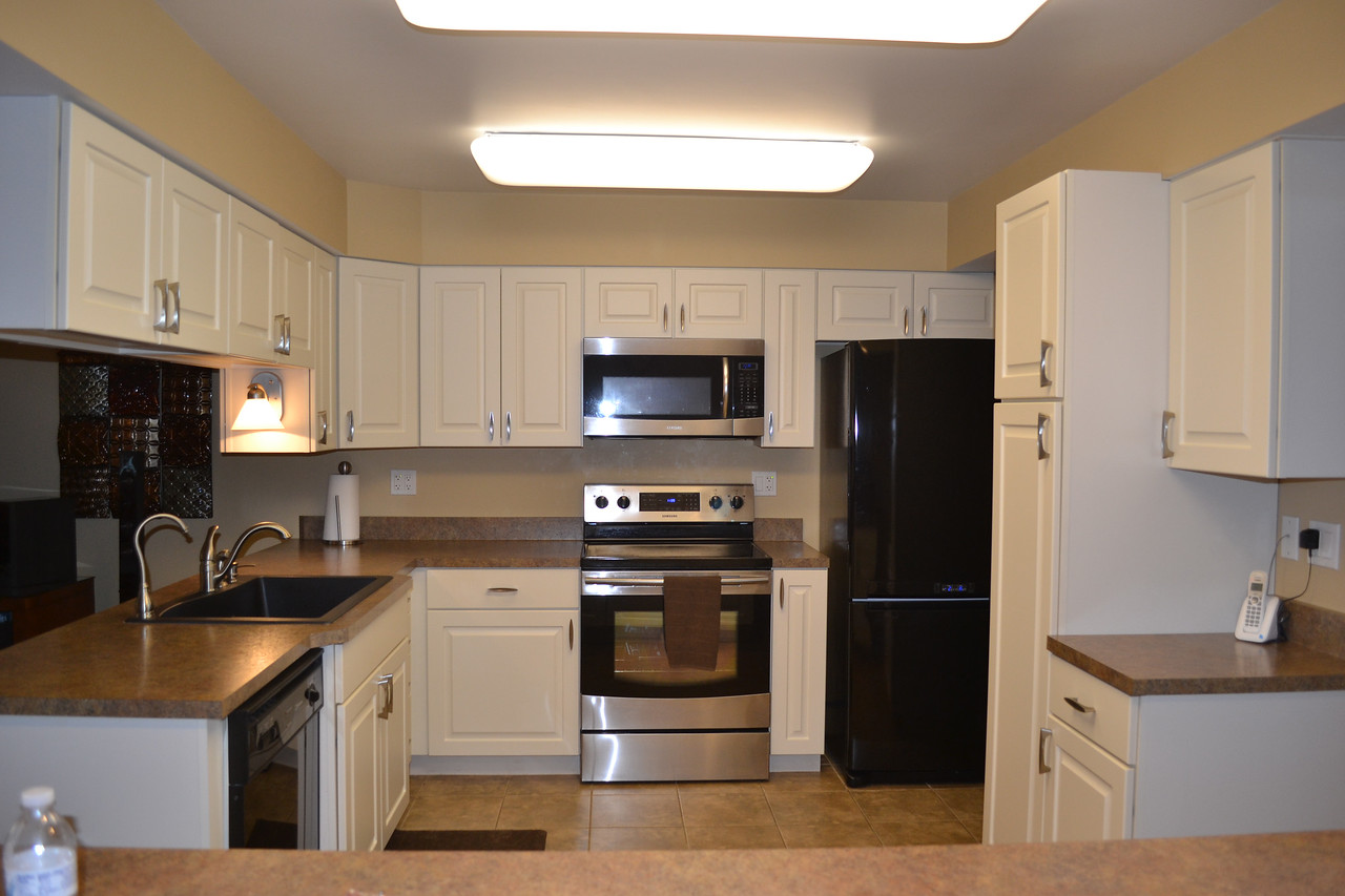 Kitchen includes a tile floor and was completely remodeled in 2010 with all new appliances (appliances are still under warranty.)