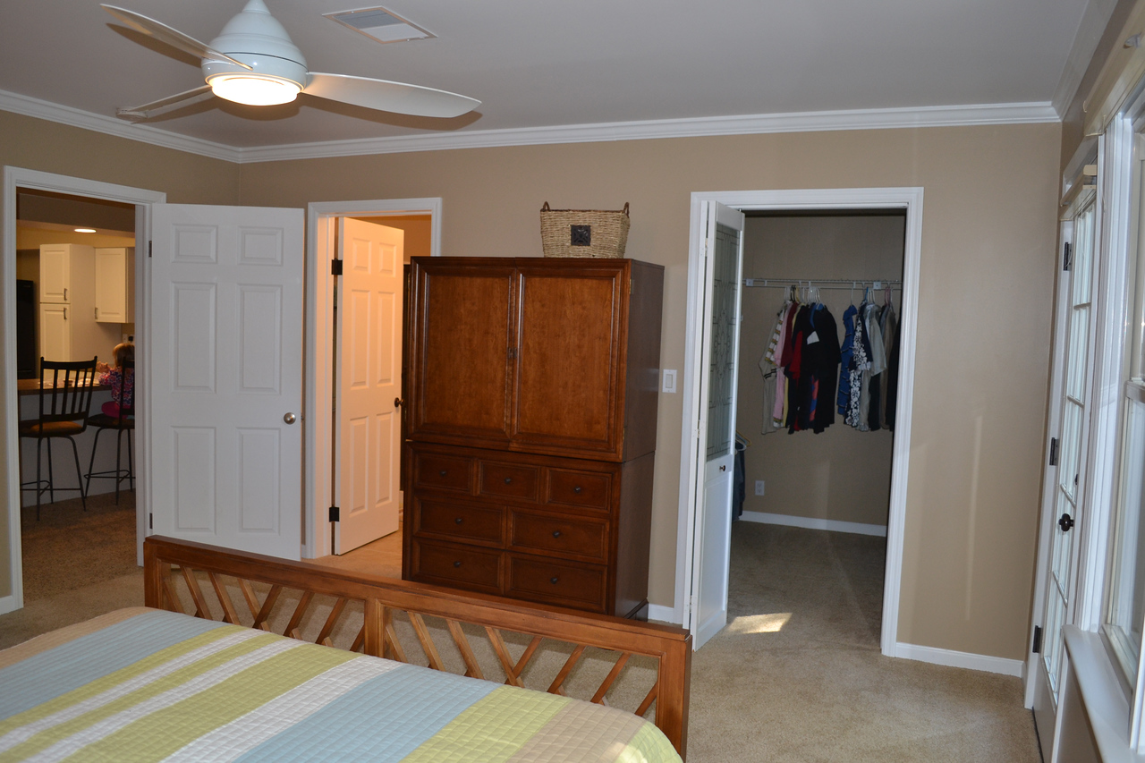 Master bedroom with private bath, walk-in closet, and a secluded side patio.