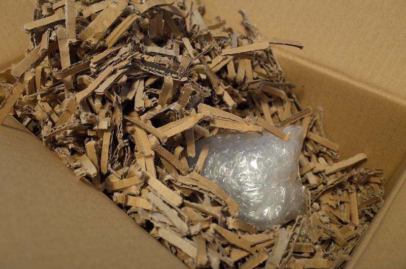 microscope_objective_shredded_cardboard_packaging_bubble_wrap