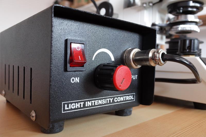 Radical microscope incident illuminator transformer switch electric