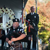 """Day of Remembrance, September 11, 2015, in honor of first responders and those killed in the World Trade Center attacks 14 years ago. <br /> <br /> Lt. Steve Hoffeditz, Clackamas Fire District #1 stands on stage while Clackamas Pipe and Drums play Amazing Grace. © 2015 TriMet / Fred Joe /  <a href=""""http://www.fredjoephoto.com"""">http://www.fredjoephoto.com</a>"""