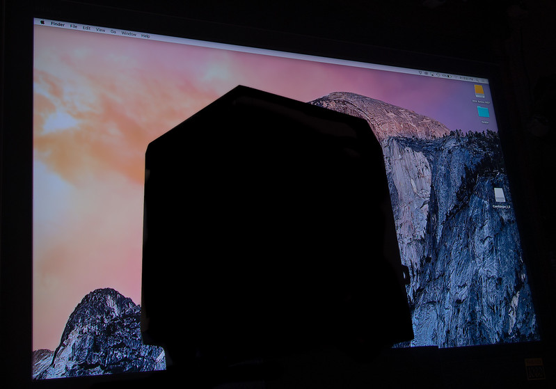 The November 2016 competition was about silhouettes. This is an original 1985 Macintosh computer in front of the desktop image from the current Macintosh operating system. A better picture would have included some subtle details from within the silhouette, which would have revealed the screen and provided a better clues as to what that dark object. Unless you recognize that, the playfulness of the image cannot be understood. My reading of the definitions said that was not allowed, but most of the images the judge selected did have interior lighting within the silhouette.