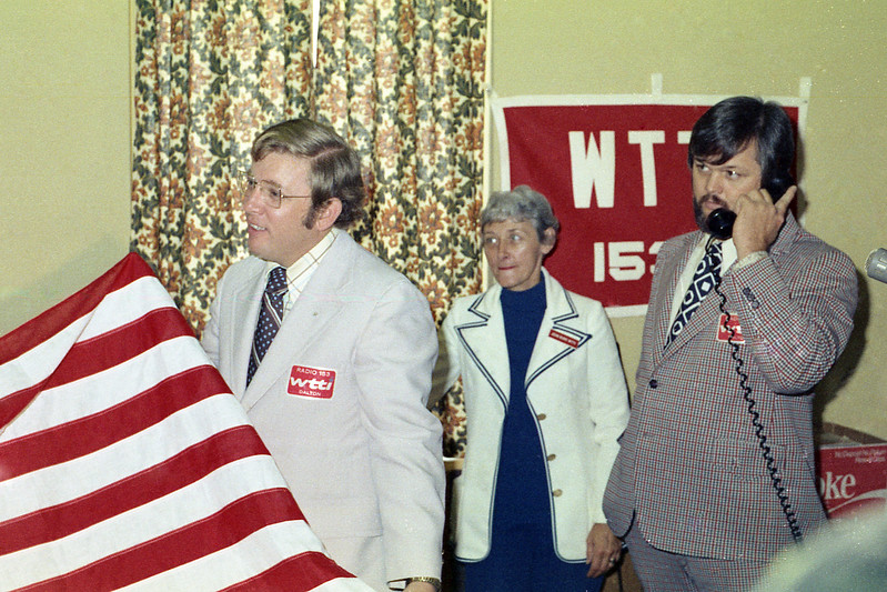 7th District U.S. Representative John Davis presented a flag (to WTTI?) that had flown over the U.S. Capitol Building in a small ceremony at the WTTI office over the former Dalton Federal Building in downtown Dalton. Possibly 1973. WTTI Radio's Ron Arnold, Jean Burr and Ken Mynatt were also present.