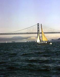 Sailing under the San Francisco - Oakland Bay Bridge (1974).