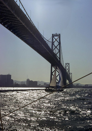 Sailing under the San Francisco - Oakland Bay Bridge (1974).