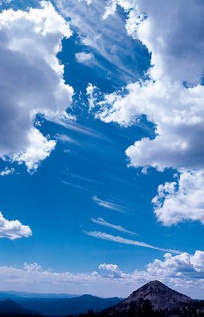 Horsetail cirrus clouds  mean fair weather! John Muir Wilderness, Sierra Nevada. (May 1975)