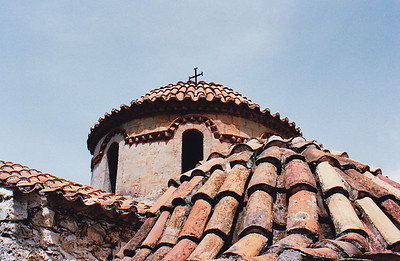 The roof and one of the smaller terracotta-tiled domes of the Pantanassa Convent at Mystras.