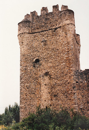 Close-up of a typical Mani Tower, located near Gythio on the Mani Peninsula of Sparta.   During the Ottoman invasion (circa 1770) of the Peloponnese Peninsula, the Maniots had a reputation as proudly independent warriors. They lived in fortified villages and house-towers where they defended their lands against the Ottomans until 1827, when the Ottoman invasion of Greece was stopped by the combined forces of Great Britain, France, and Russia at the Battle of Navarino at modern-day Pylos on the west coast of the Peloponnese Peninsula.