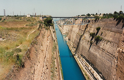 The Corinth Canal cuts through the Isthmus of Corinth and physically separates the Peloponnesian Peninsula from the rest of mainland Greek. It is a single channel 8 metres (26 ft) deep and 6.4 kilometres (4.0 mi) long, but only about 21 metres (70 ft) wide at sea level, making it unnavigable by most modern transport vessels. Completed in 1893.
