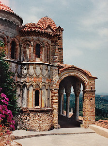 The Monastery of the Pantanassa: exterior decoration on the sanctuary apses and the stoa. It is an excellent example of Frankish architecture. It is currently occupied by nuns who provide hospitality services for visitors. It is the most conspicuous of the buildings on the Mystras site.