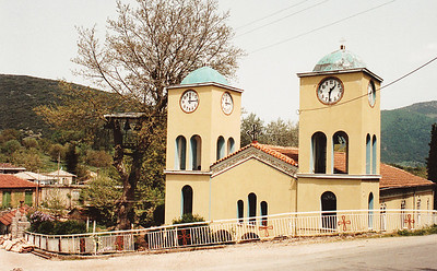 Twin bell towers of a village church, Achaea Province, northern Peloponnesus. Note the two differing times shown on the clock faces.