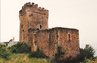 A typical Maniot Tower, located near Gythio on the Mani Peninsula of Sparta. About 20 meters high and has 4 to 5 floors. The more than 800 surviving Mani towers were very carefully planned. Used as a residence as well as a defensible military strong point, each tower included a high-walled courtyard. They were equipped with loopholes, boilers for water, and special places at tower corners for throwing stones at enemies.   During the Ottoman invasion (circa 1770) of the Peloponnese Peninsula, the Maniots had a reputation as proudly independent warriors. They lived in fortified villages and house-towers where they defended their lands against the Ottomans until 1827, when the Ottoman invasion of Greece was stopped by the combined forces of Great Britain, France, and Russia at the Battle of Navarino at modern-day Pylos on the west coast of the Peloponnese Peninsula.