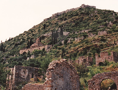 A panoramic shot of Mystras, near the modern city of Sparti in Laconia Province. Villehardouin's Castle and small palace surmounts the hilltop (upper right corner of photo). Built as an amphitheater around the fortress erected in 1249 by the prince of Achaia, William of Villehardouin. Reconquered by the Byzantines, then occupied by the Turks and the Venetians, the city was abandoned in 1832.  Link to Wikipedia's map PLAN OF MYSTRAS   Link to UNESCO website: Archaeological Site of Mystras.