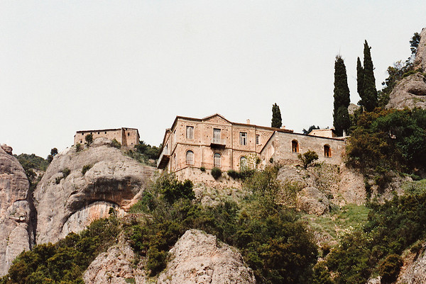 An isolated monastery perched atop a steep cliff face, Laconia Province, Peloponnesus.