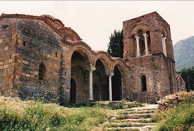 The façade of Saint Sophia Church, Mystras. Located in the district of the Despot's Palace, it served as the palace church, the catholicon of a small monastery, and the royal tombs. Built between 1351 and 1365. Its tall, narrow structure and the use of columns in the bell tower and in support of one side of the dome is unusual for Byzantine churches of the period. During the Ottoman occupation of Mystras, the building served as a mosque, the bell tower was its minaret. The Cloisonné brickwork is more typical of Byzantine architecture.