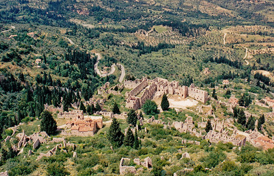 A view of the Upper City of Mystras from the citadel of William of Villehardouin's Castle (uphill). The large structures in the middle of the photo are the ruins of the Despot's Palace