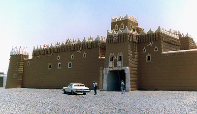 The Emir's Mud Fort outside Najaran in southern Saudi Arabia near the border with Yemen. This mud brick fortification shows all the elements typical of architecture of similar structures in the Asir Region, such as the characteristically intricate lime-whitewashed turrets and crenellations. Load-supporting members are all made of palm wood trunks. The more than 60 interior rooms are completely whitewashed. Shuttered windows are cut into exterior walls to allow hot air to rise and exit the room, thus promoting air circulation. Intended as a defensive position to ensure that the military forces of the Imam of Yemen were not able to invade this part of the new Saudi kingdom in support of his claim to Najaran, construction of the mud fort began in 1942. The fort was abandoned in the late 1960s when the Kingdom of Saudi Arabia normalized relations with North Yemen.
