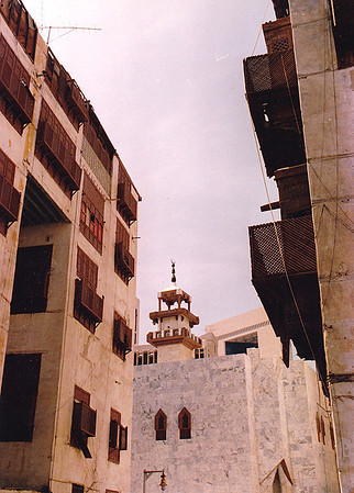 "A modern minaret tops the structure of a rebuilt mosque on the site once occupied by one of the oldest mosques in Jeddah. One of the many sobriquets given the city in the distant past was ""Jeddah of the Thousand Mosques."" I'm not certain that count was an exaggeration: during prayer call, one could nearly go deaf from the chanting of hundreds of muezzins calling the faithful to prayer five times a day."