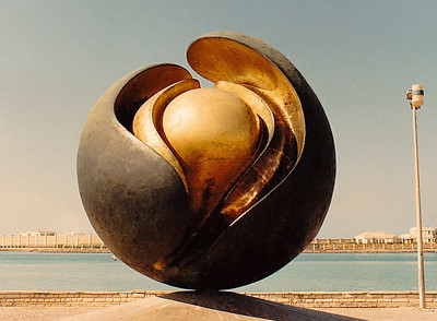 An abstract bronze-and-brass sculpture by Henry Moore sits atop a small plinth on the Corniche, a very scenic street that winds along the coastal district of Jeddah.