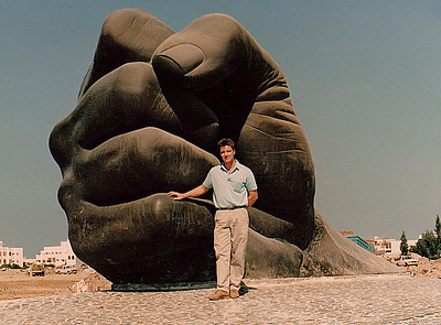 """This monumental bronze-cast sculpture, known locally as """"The Fist of Sultan"""" (or simply """"The Fist""""), adorns Al Amir Sultan Street, one of the main thoroughfares crossing the heart of Jeddah. Numerous similarly massive artistic sculptures line the main streets of the newer districts of Jeddah."""