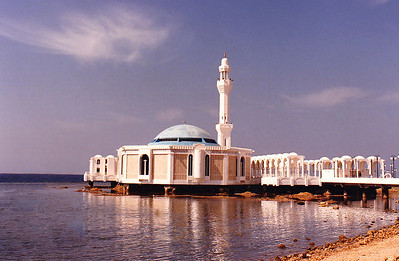 """THE FLOATING MOSQUE: This was my favorite mosque! In Arabic, it is called a """"masjid."""" Simple yet elegant, it was unique for its time in that it was built on a pier whose pilings were anchored in the coral shallows along the Corniche Road. Locally, it is known as a mosque for which Indonesian Muslims have a particular affinity when visiting for Hajj or Omrah.   Officiallly, it is called Fatima az-Zahra Mosque, after the daughter of the Prophet (although it might also be referred to as al-Rahma Mosque, i.e. """"Mercy Mosque"""")."""